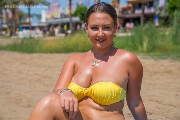 Stunning Kiwi Lexi rocking a hot yellow bikini down the beach